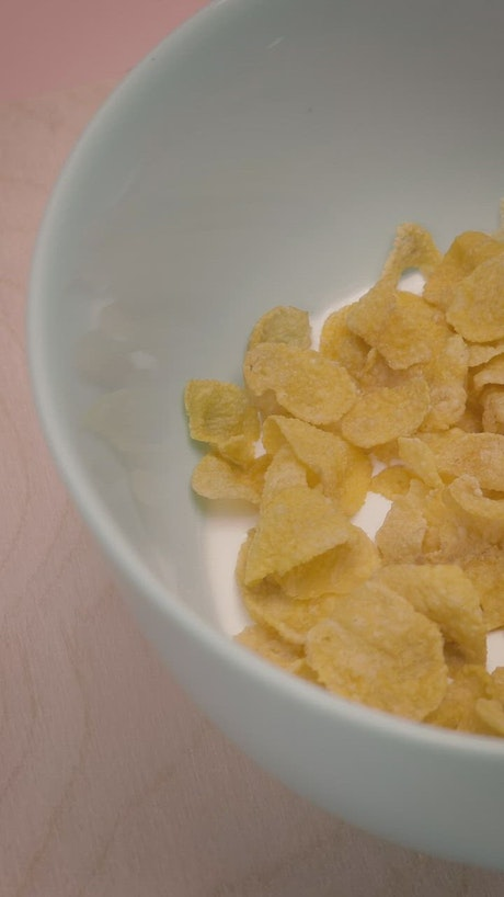 Slowly rotating bowl of corn flake cereal