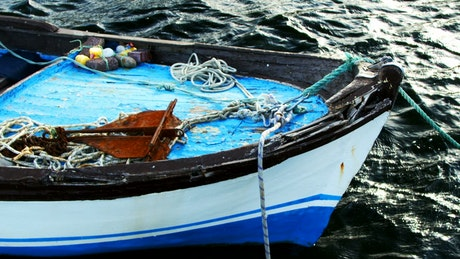 Small anchored fishing boat seen in detail