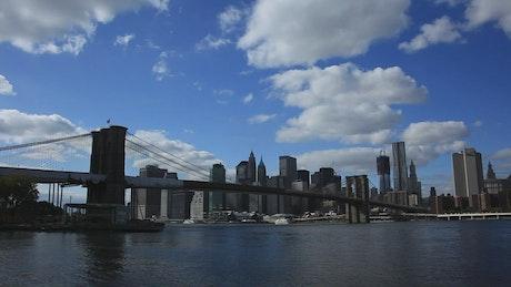 Small boats below the Brooklyn Bridge