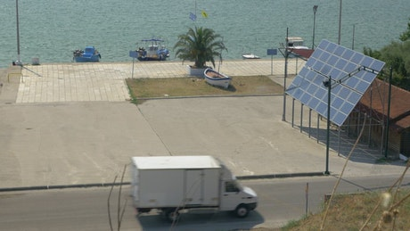 Small boats by a solar panel