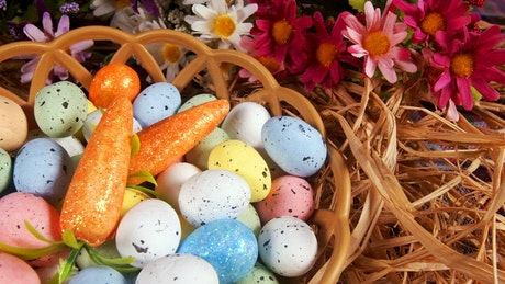 Small colored easter eggs in a basket