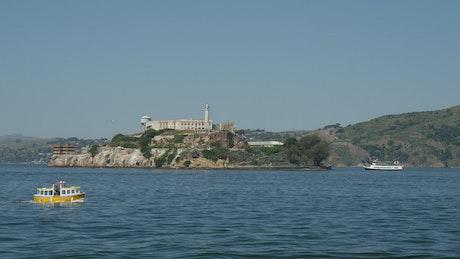 Small cruise ship passing by Alcatraz Island