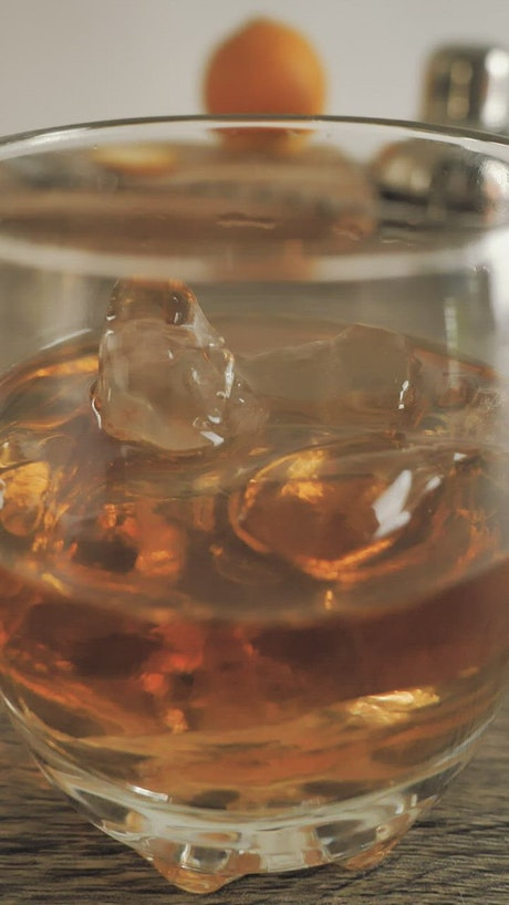 Small glass with whiskey on the rocks