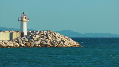 Small lighthouse on the seashore