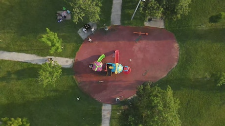 Small playground in the middle of a large park