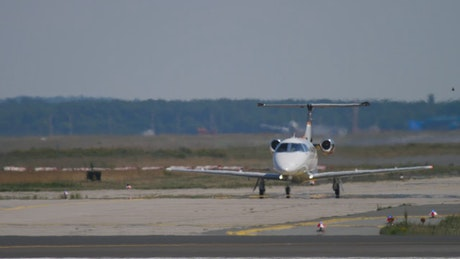 Small private jet landing at the airport