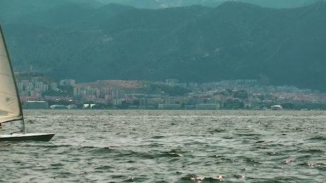 Small sailboat sailing the sea