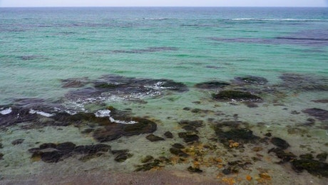 Small sea waves and clear water