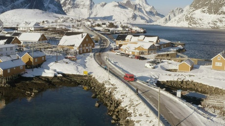 Small town covered in snow by the ocean