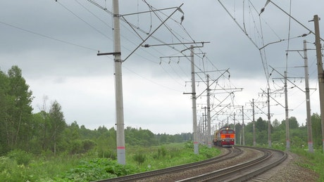 Small train heading towards a city