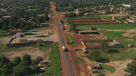 Small village in Mali with traffic heading through