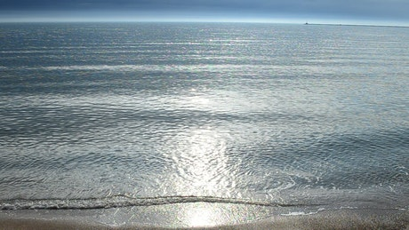 Small waves breaking on the sand