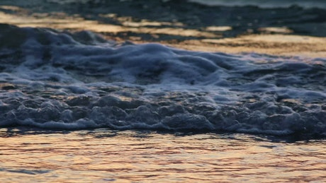 Small waves under a setting sun