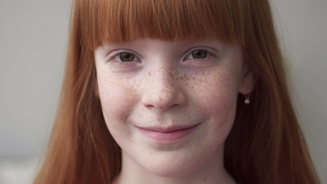 Smiling girl with freckles