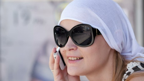 Smiling while on the telephone