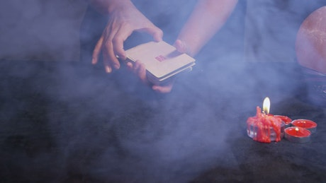Smoke clearing over Tarot Cards