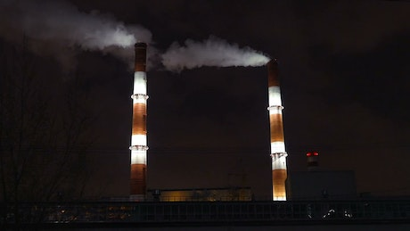 Smoke coming from a factory at night