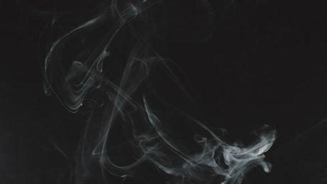 Smoke effect over black background