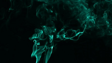 Smoke with fluorescent particles on black background