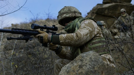 Sniper providing cover for patrol