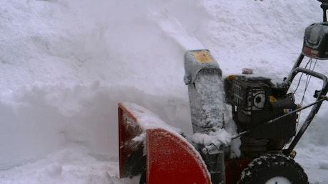 Snow blowing machine working
