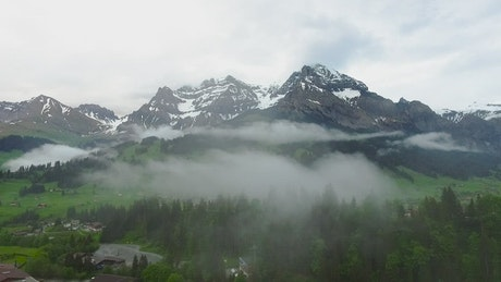 Snow topped mountains and mist