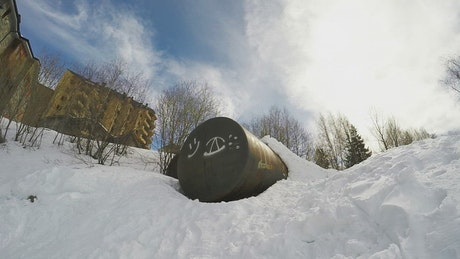 Snowboarder flipping on a jump