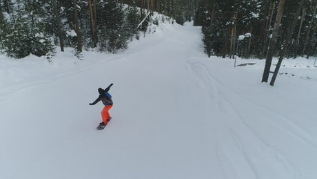Snowboarding down a small hill