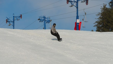 Snowboarding down the hill
