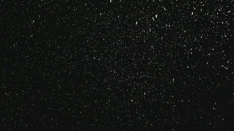 Snowing with dark background