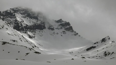 Snowy mountain landscape with clouds