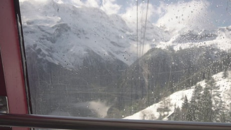 Snowy mountains seen from a cable car station