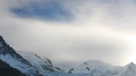 Snowy mountains with mist