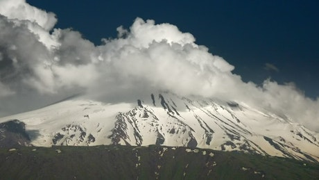 Snowy peak with clouds