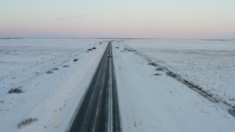 Snowy road in a plain view from the air