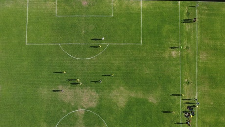 Soccer match on a grass court from above