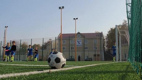 Soccer players scoring a goal