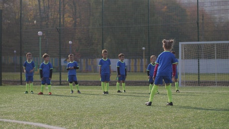 Soccer players stretching during training