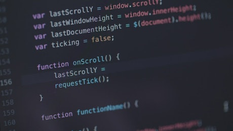 Software developer working on code, screen close up