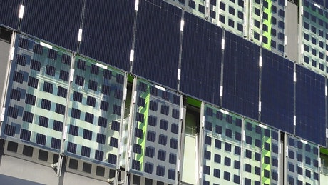 Solar panels attached to the side of a building