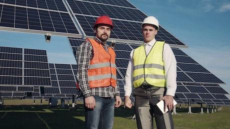 Solar power engineers posing to camera