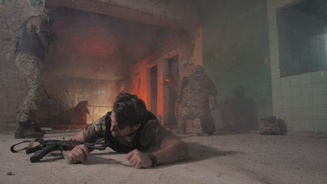 Soldier crawling away from a fire