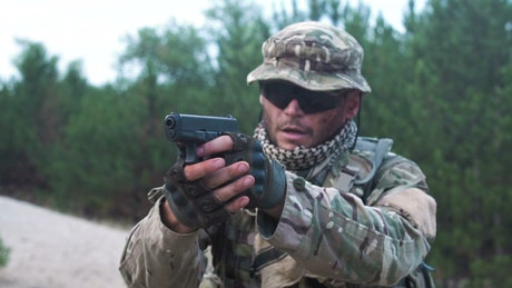 Soldier outdoors shooting the gun