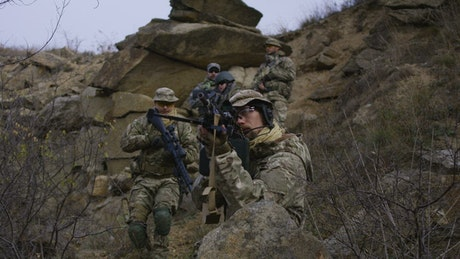 Soldier patrol going down the hill