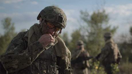 Soldier smoking in the field