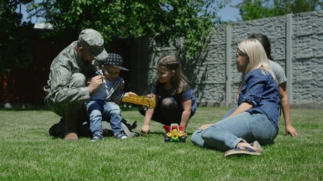 Soldier spending time with family in the garden