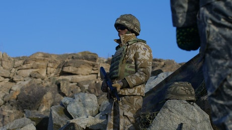 Soldier standing in the countryside