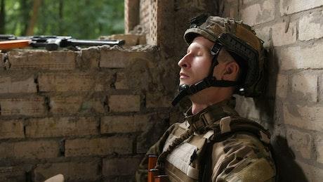 Soldier taking off their helmet