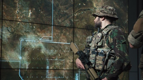 Soldier watching a missile launch on the screen