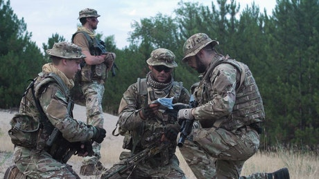 Soldiers checking the strategy on the map